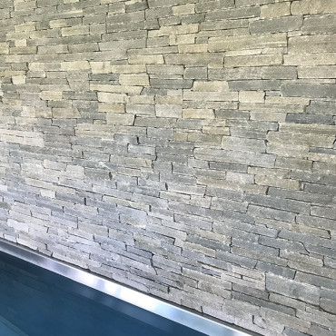 Swimming pool and the stone wall