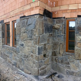 Realization of stone facade - Massive Rock