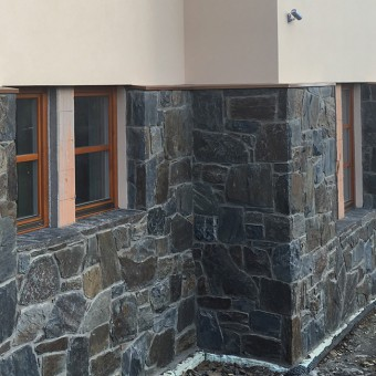 Detail of stone facade and window sils - Massive Rock