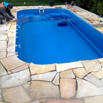 Stone tiles in the pool - Solid Quartzite